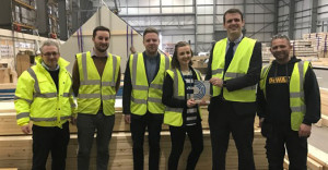 Smartroolf team pictured with Construction News Award